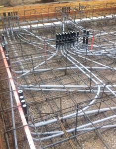 Conduit rough-in before a concrete pour.