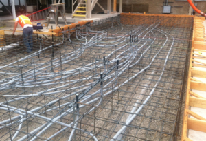 The conduits are properly supported and the transition to the vertical stub-ups are wrapped rigid conduit. Conduit routes were planned and installed to support control wiring and power to each of the units to be installed on the finished pad. When complete, the chiller and it's peripheral devices will all be interconnected and powered up.